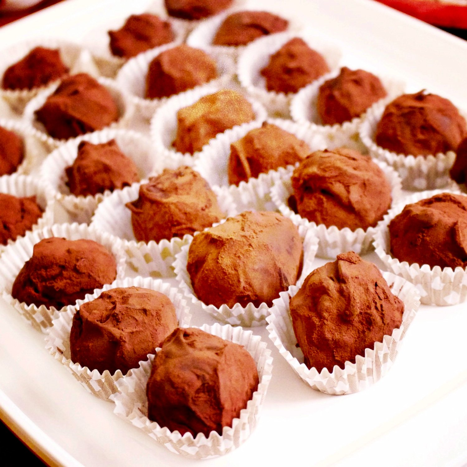 Easy Delicious Chocolate Truffles are an awesome dessert to make that is perfect for holidays and Valentine's Day. The truffles are great for the holidays.