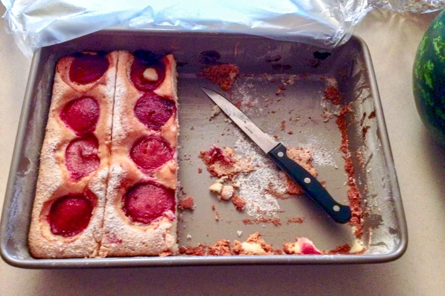 Plums Coffee Cake- in the baking pan with knife