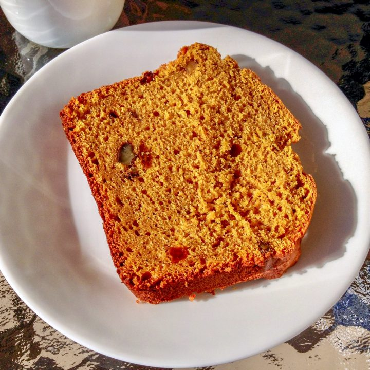 Pumpkin Bread With Walnuts And Raisins Recipe- slice of bread on white plate, close up