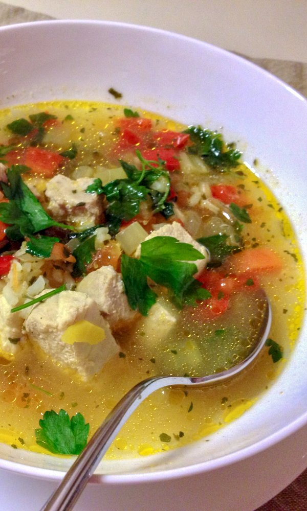 Sour Fish Soup Romanian style- in a white bowl