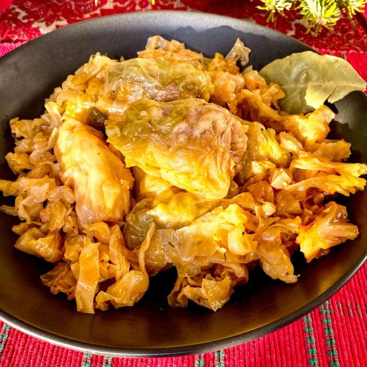 Stuffed cabbage rolls on black bowl square photo1