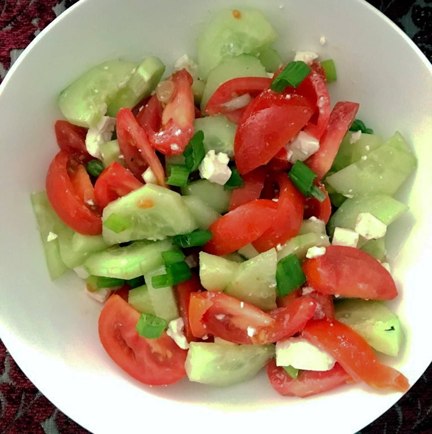 Tomato Cucumbers Feta Salad Recipe is a traditional authentic Romanian salad that can be made all year round. The salad doesn't use vinegar or lemon juice in the dressing, only sunflower oil, salt and pepper. Simple and delicious!