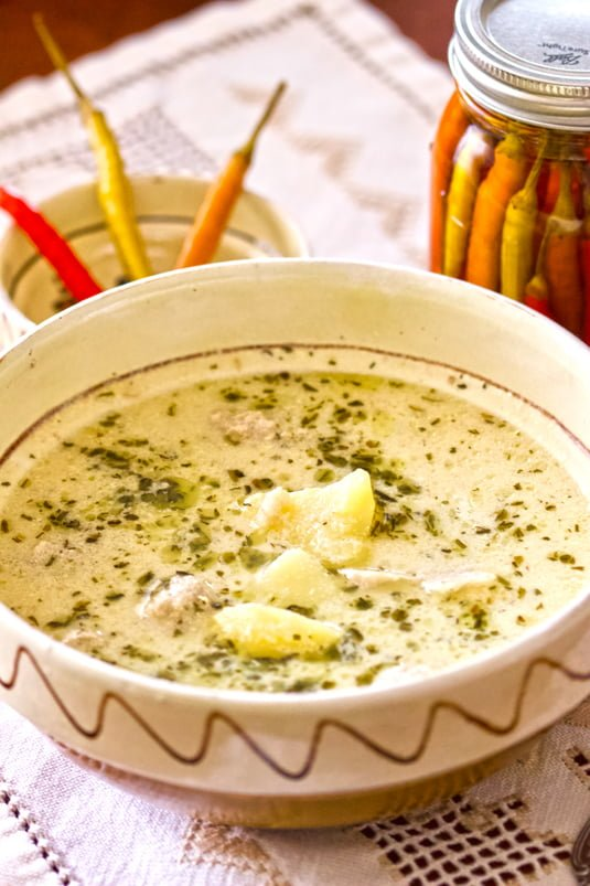 This Traditional Saxon Potato Tarragon Soup From Transylvania is a delicious comforting soup that is perfect during the winter season. The soup is made with starchy potatoes and meat, usually pork or smoked ham and it is flavored with tarragon, sour cream, and vinegar for an extra zing.