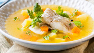 fish soup in a white bowl square