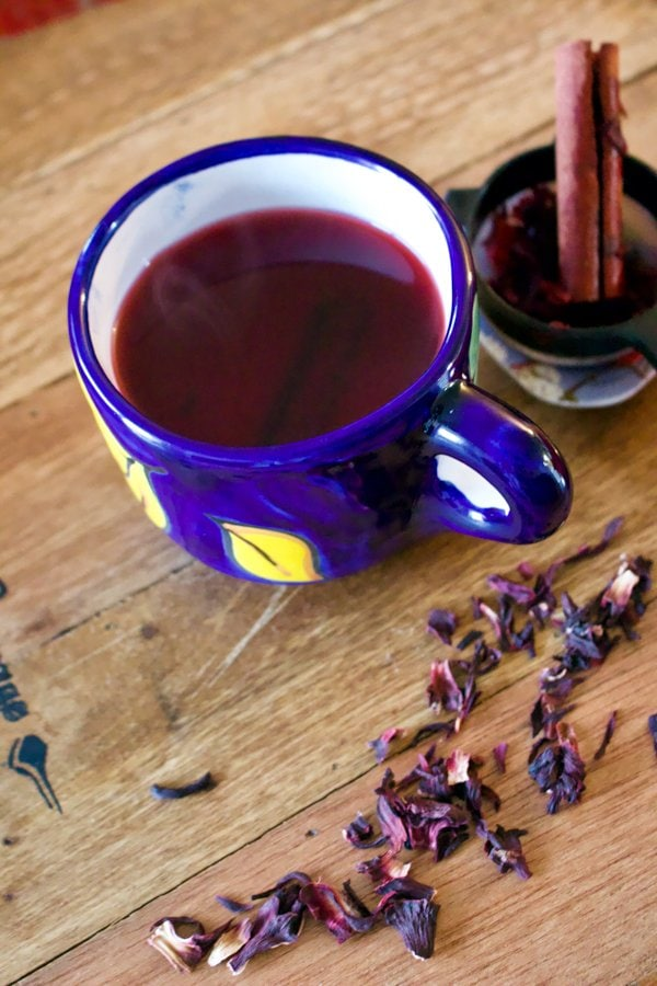 Hibiscus-Cinnamon Tea- Te de Jamaica y Canela- I am sharing with you another favorite, a popular tea that is consumed wildly in Mexico and not only, the famous Hibiscus flower tea, or Jamaica flowers te in Spanish. If you know the Mexican cuisine, you also know that this tea is called Agua De Jamaica.