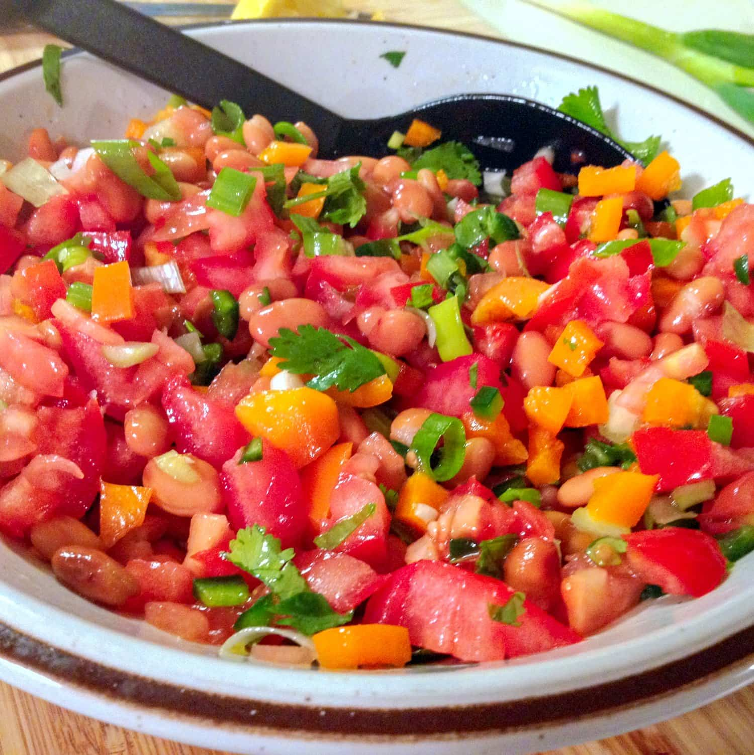 The Mexican Pinto Bean Salad with Jalapeno pepper is a super easy meatless recipe that can be made in no time. It is suitable all year around, and it is a good source of protein and fiber for all of us.