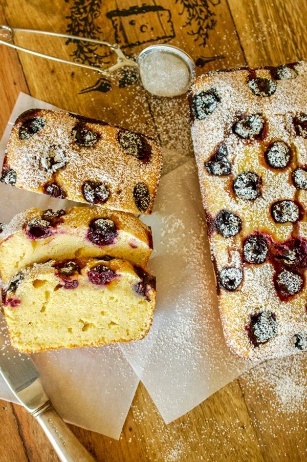 This Sour Cherries Sweet Cornbread is a rustic Romanian sweet bread that is made with cornmeal, semolina and all purpose flour. Very easy to put together and delicious, the recipe makes two loaves of sweet bread. Perfect for potlucks or rustic parties.