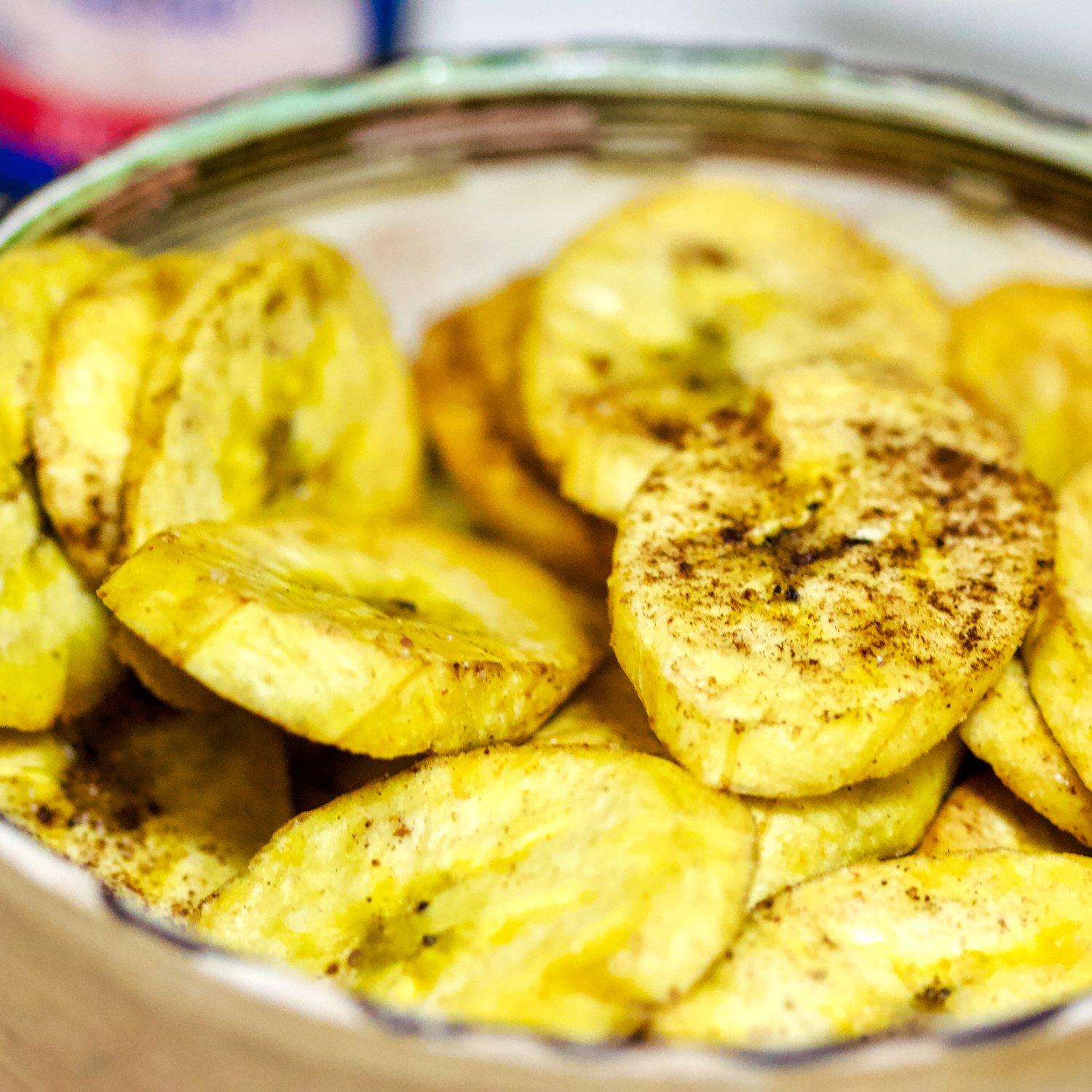 spiced plantain chips in a bowl- close up