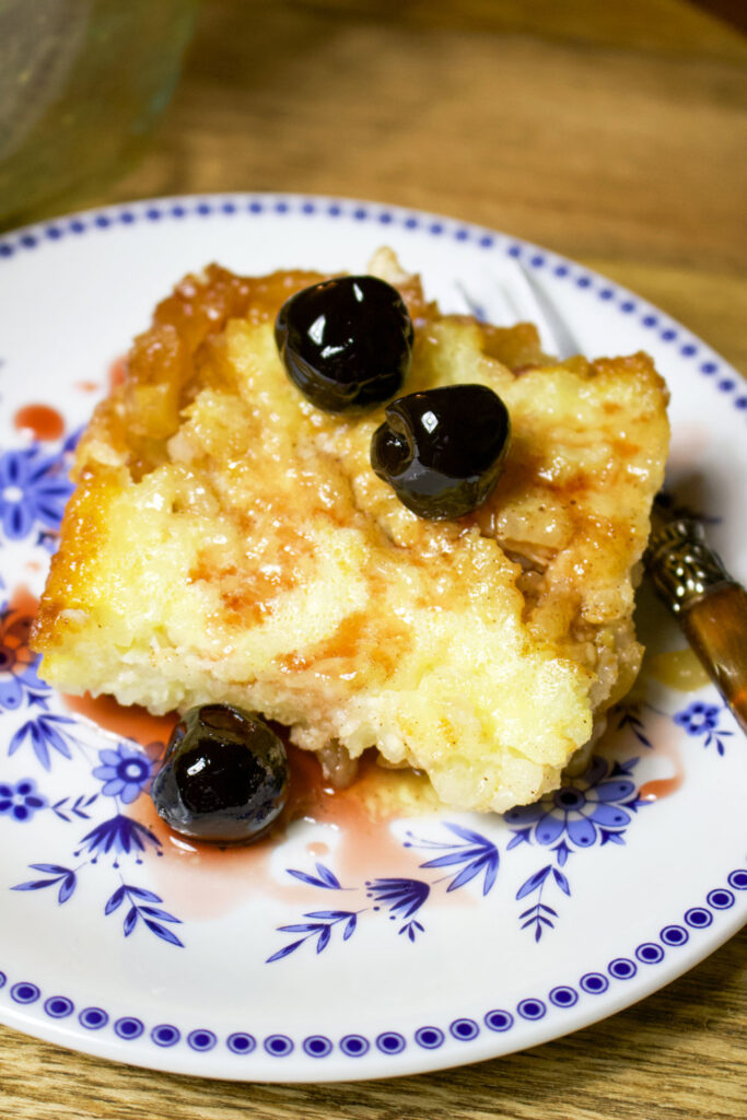 Baked Rice Apple Pudding slice on plate with fork0
