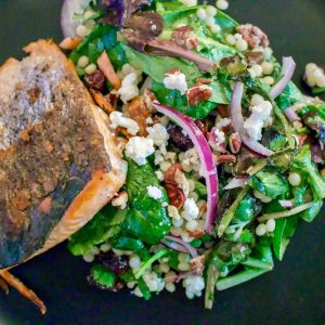 This Fresh Baby Spring Greens Couscous Pecans Salad With Grilled Salmon recipe is a delicious, beautiful dish that can be made any time of the year. The salad, served with fresh grilled salmon is also perfect for entertainment.
