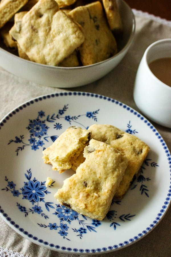 Apricot And Sour Cream Scones  broken pieces of a scone on a white plate with blue pattern
