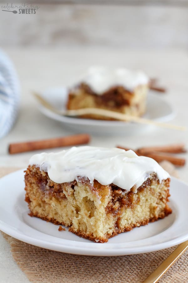 Slice of cinnamon roll cake on a white plate.