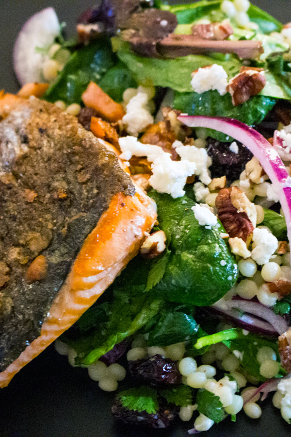 Fresh Baby Spring Greens Couscous Pecans Salad With Grilled Salmon close up