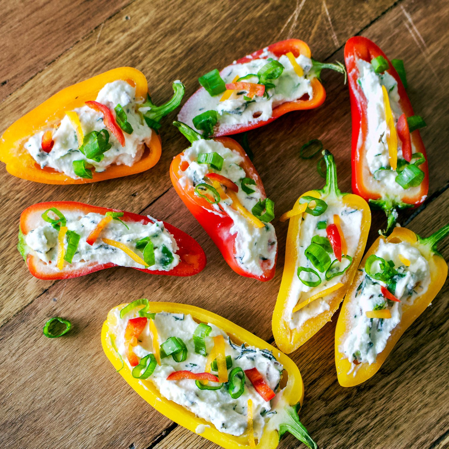 Mini Peppers Stuffed With Farmer Cheese-Are you looking for a fun&festive little appetizer to make for your next party? Here is a recipe that can be made ahead. Mini peppers stuffed with farmer cheese is a super easy to put together recipe that is delicious and also beautiful on the table.
