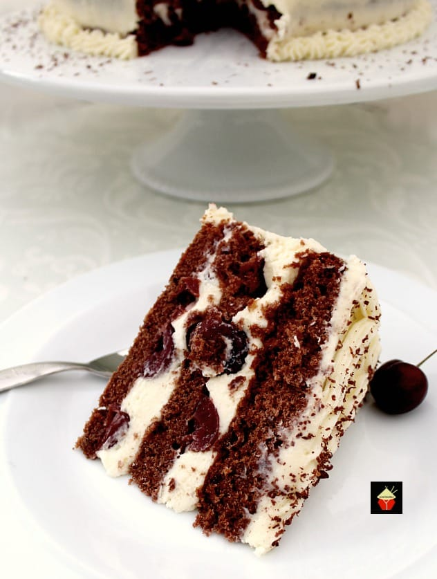 Authentic German Black Forest Cake, Schwarzwalder Kirschtorte is a delicious cake famous in Germany. Layers of chocolate cake, black cherries and kirsch. Perfect for a party!