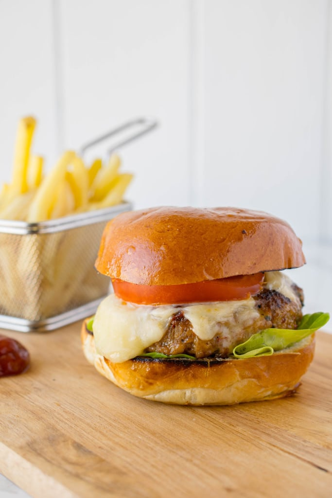 Juicy and very flavorful, this chipotle chicken burger mixes finely chopped onion, red pepper, cilantro and a little kick from chipotles in adobo right into the ground chicken meat. Prepare for a tastefest because this will satisfy any burger craving.