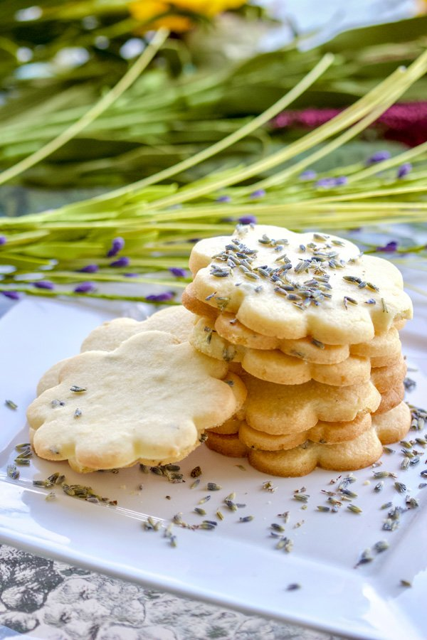 Lemon Lavender Butter Cookies - stacked cookies on a white plate