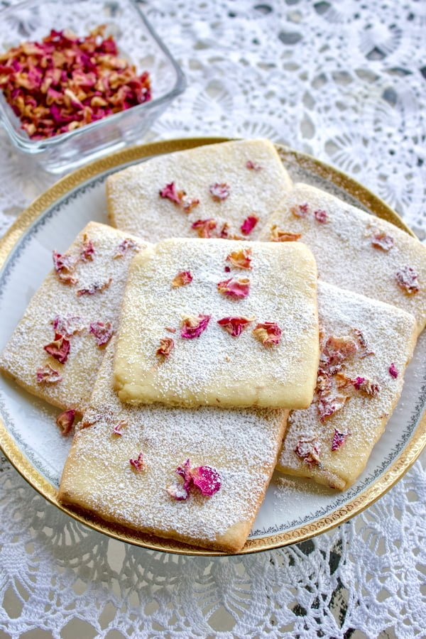 Rose Petals Butter Cookies on a white platter with golden rim