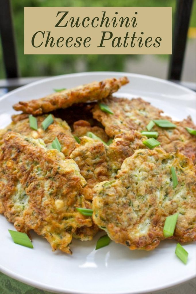Zucchini Cheese Patties  on a white plate- featured picture for Pinterest