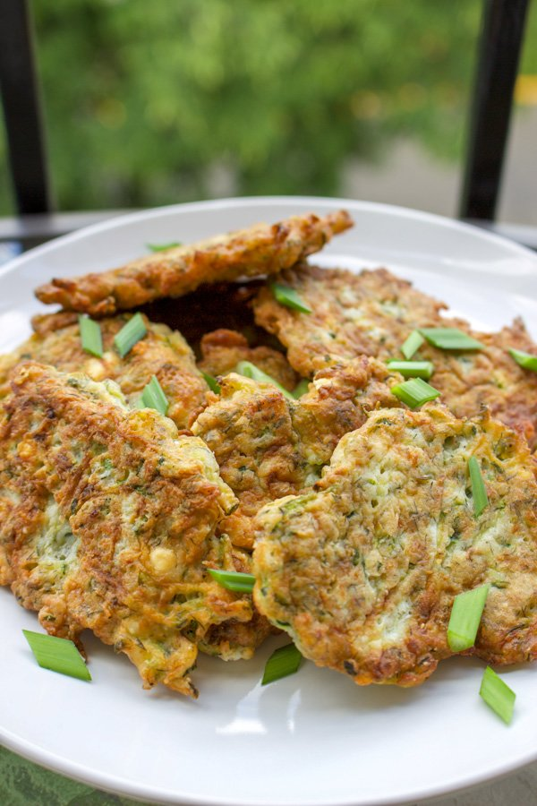 Zucchini Cheese Patties is a summer dish that is easy to make and delicious. These patties are made with Feta cheese and dill, which are traditional ingredients for this Romanian summer recipe.