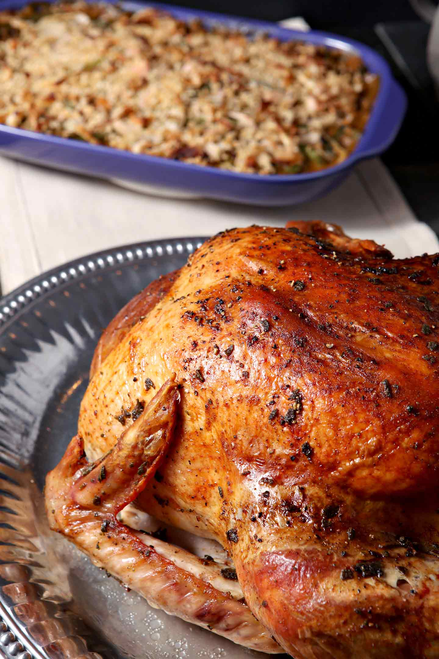 Prepare a showstopping entree for the holidays this year! Browned Butter Sage Turkey is a decadent twist on the classic roasted turkey. Brown butter in a pan with fresh sage, then slather a Honeysuckle White Fresh Whole Turkey with the sage browned butter. Bake until golden brown, and serve warm with homemade gravy and traditional sides! This turkey makes a flavorful entree for Thanksgiving or ANY holiday celebration! #ad #HonestSimpleTurkey