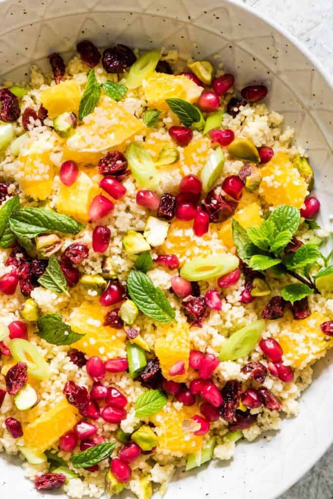 Close up of a quick and easy orange pistachio pomegranate couscous salad recipe ready in less than 15 mins. A colourful vegan and vegetarian side dish – recipesfromapantry.com