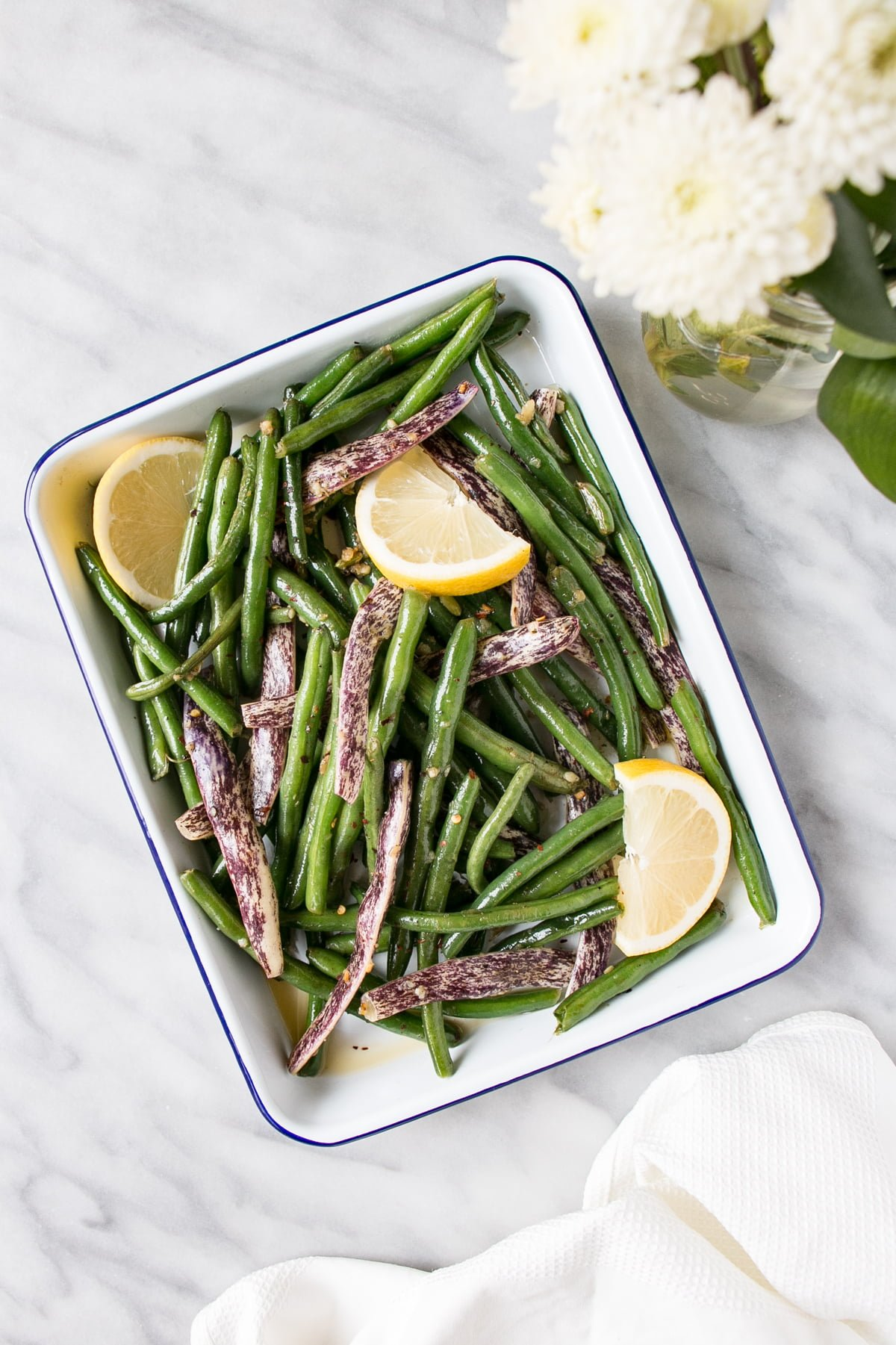 Garlicky Green Beans in a white serving tray.
