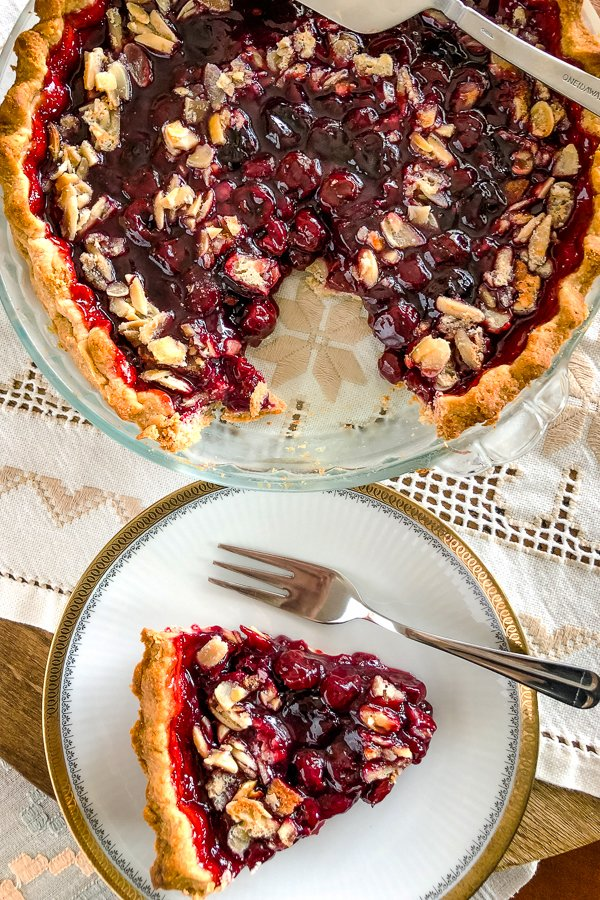 Best Sour Cherry Pie with a slice of pie on white plate
