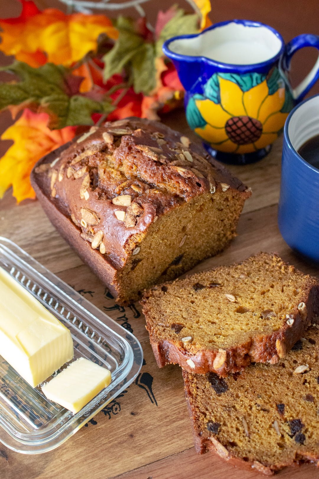Pumpkin Seed And Apricot pumpkin Sweet Bread- bread, butter and coffee sitting on the table