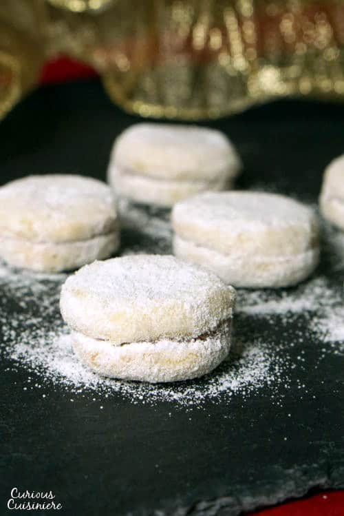 Vanilice are bite-sized Serbian Vanilla Cookies that are seriously addicting. With a nutty sweetness and a soft jam filling, they're the perfect recipe to add to your next cookie platter!   www.CuriousCuisiniere.com