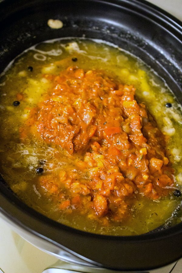 Beans With Pork Shank In The Crock Pot- sauce added to the beans in the crock pot