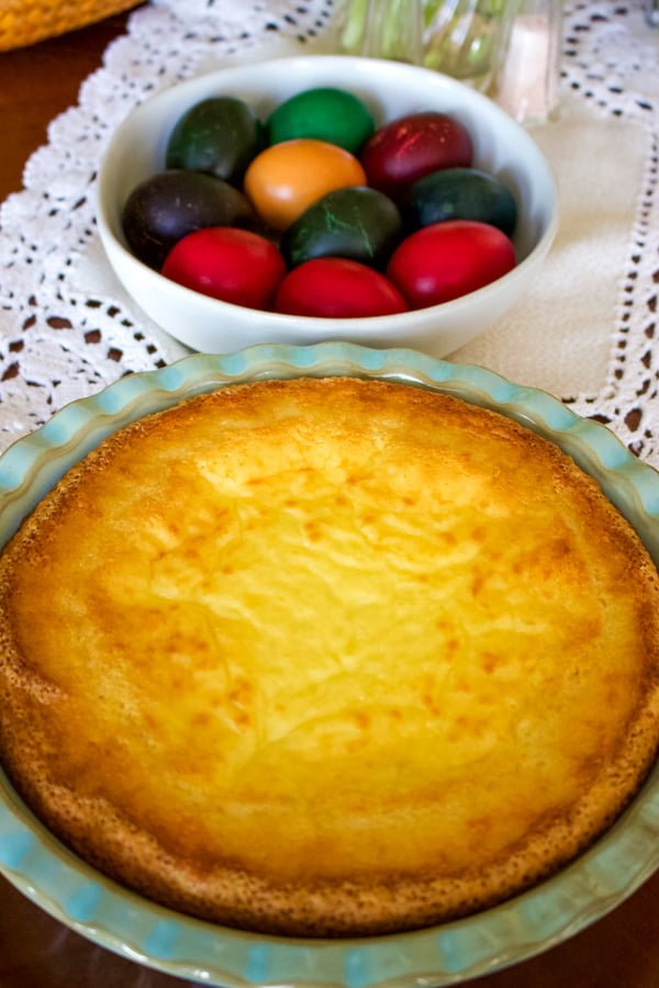 Easy Romanian Traditional Easter Cheesecake next to colored Easter eggs