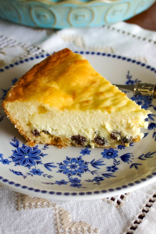 Easy Romanian Traditional Easter Cheesecake- slice of cake on a white and blue plate