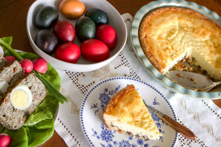 Easy Romanian Traditional Easter Cheesecake served on a plate, next to colored eggs