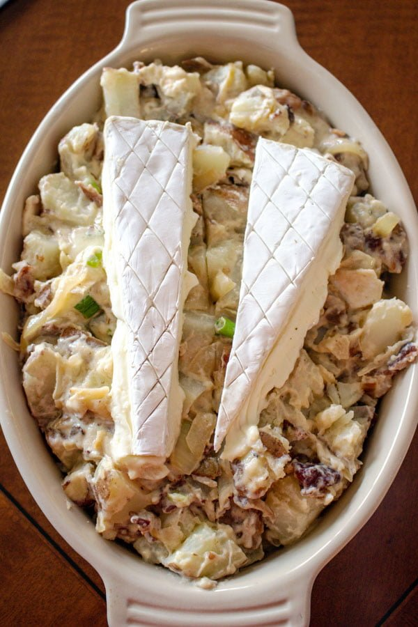 This Cheese And Bacon Potato Dish is an American version of the French Tartiflette. If you never tried a Tartiflette, you don't know what you missed. This recipe is a comforting potatoes, bacon, onions and cheese dish, where the cheese is the star.