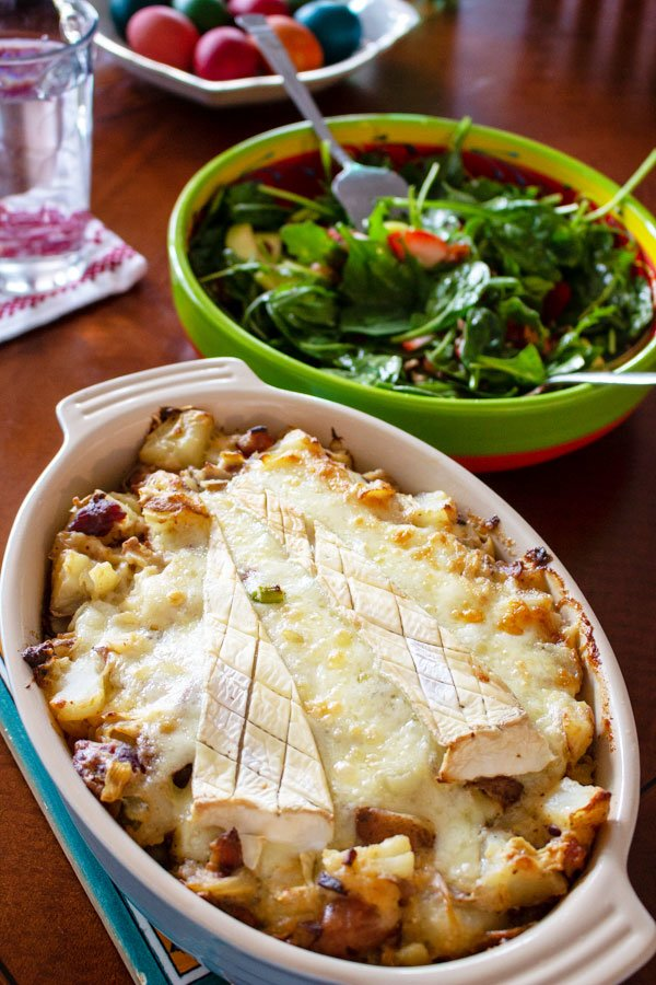 Cheese And Bacon Potato Dish is an American version of the French Tartiflette- baked Tartiflette with big bowl of salad in the background