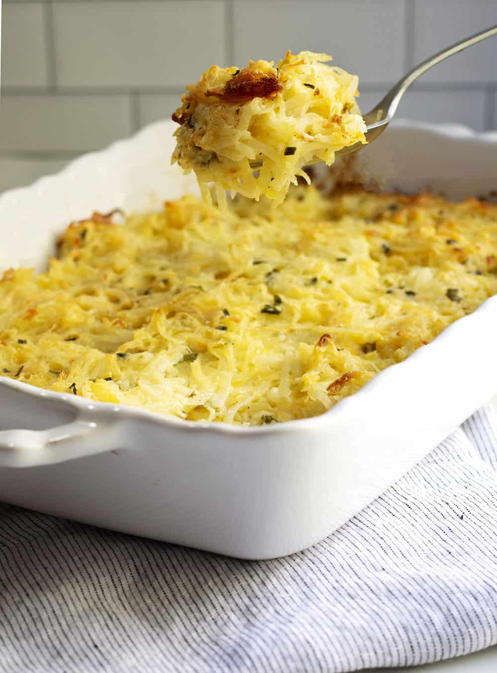 Cheesy Potatoes being served