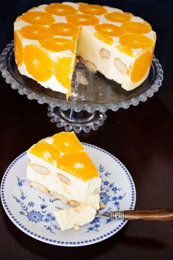 No Bake Orange Mousse Cake -slice of cake on a plate with fork