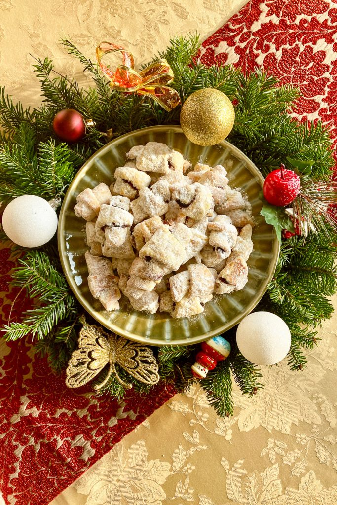 JAM AND WALNUTS RUGELACH on plate with Christmas arrangement