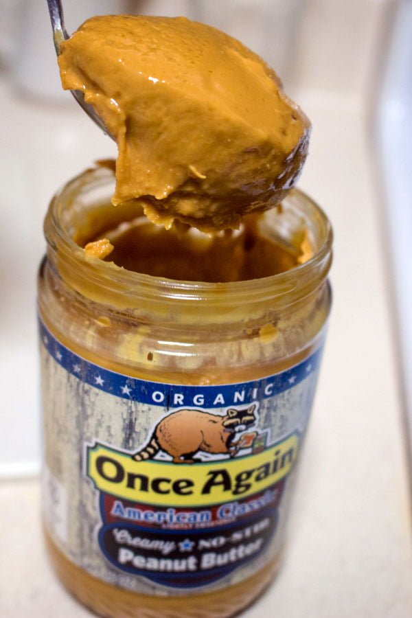 jar of peanut butter with spoon