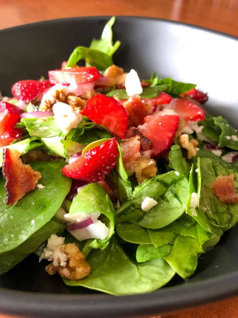 Spinach Strawberry Salad With Walnuts And Feta- close up picture