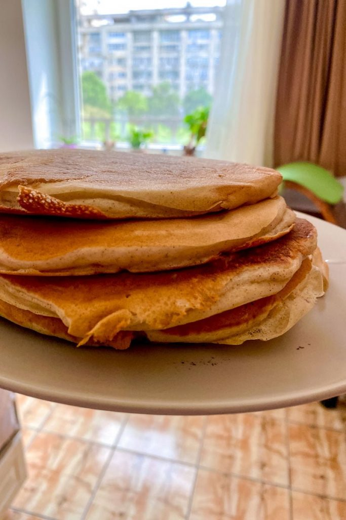 Easy Banana Buttermilk Pancakes-stack of 4 pancakes on a white plate