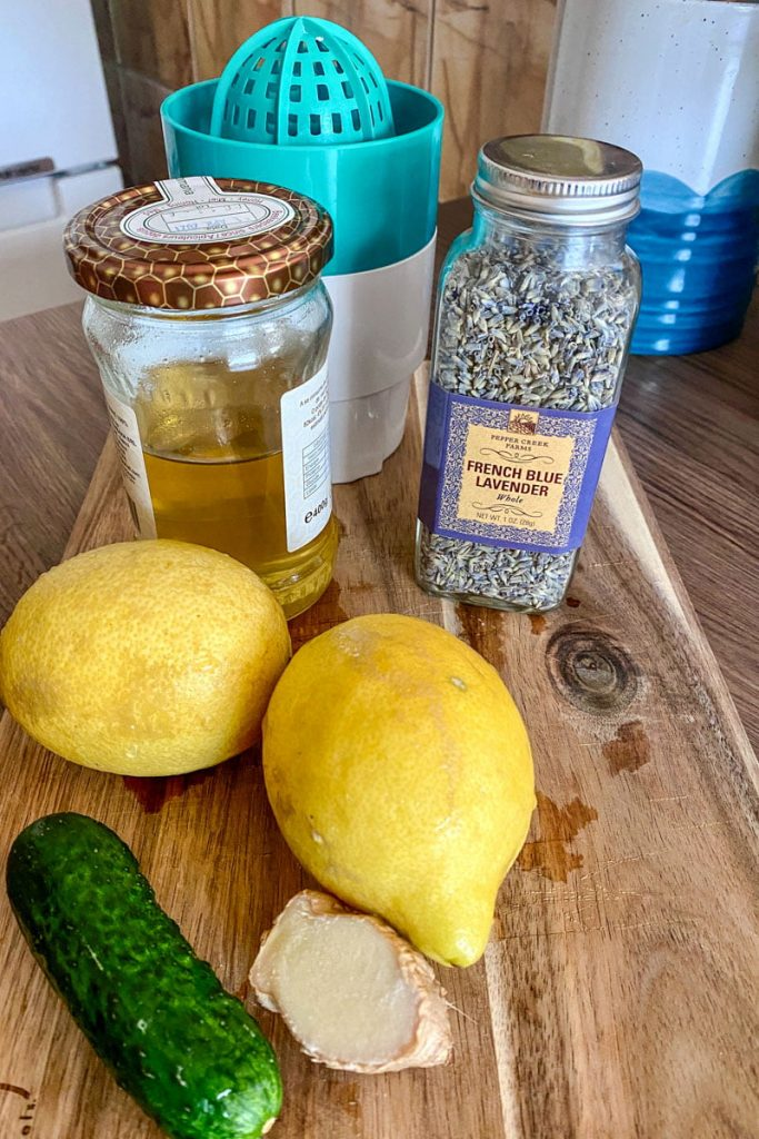 Cucumber Ginger Lavender Lemonade- ingredients gathered together on a wooden board