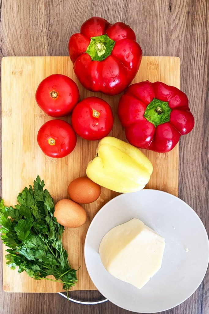 Fried peppers with tomatoes eggs and cheese- ingredients for the dish