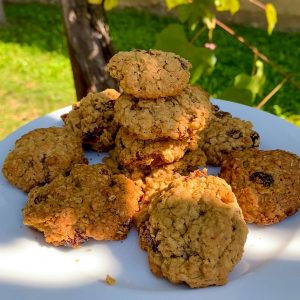 classic oatmeal raisin cookies stacked on a plate