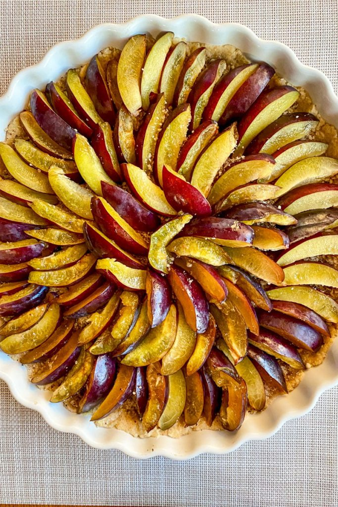sliced plums on top of the dough without the custard1