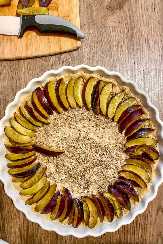 sliced plums on top of the tart