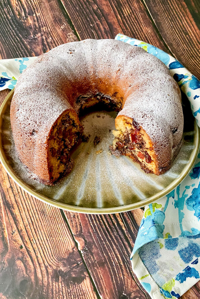 Cinnamon Swirl Coffee Cake on a platter with kitchen towel0