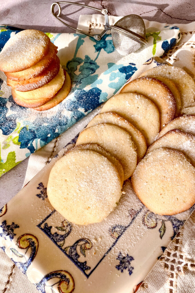 Lemon cream cheese cookies with powder sugar on blue and white towel0