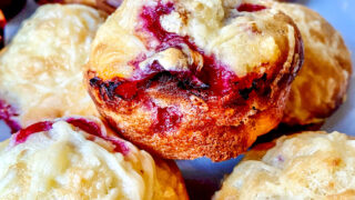 cranberry muffins stacked on a plate0
